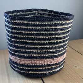 BLACK AND NATURAL RAFFIA BASKET WITH SOFT PINK STRIPE FROM DOMOINA